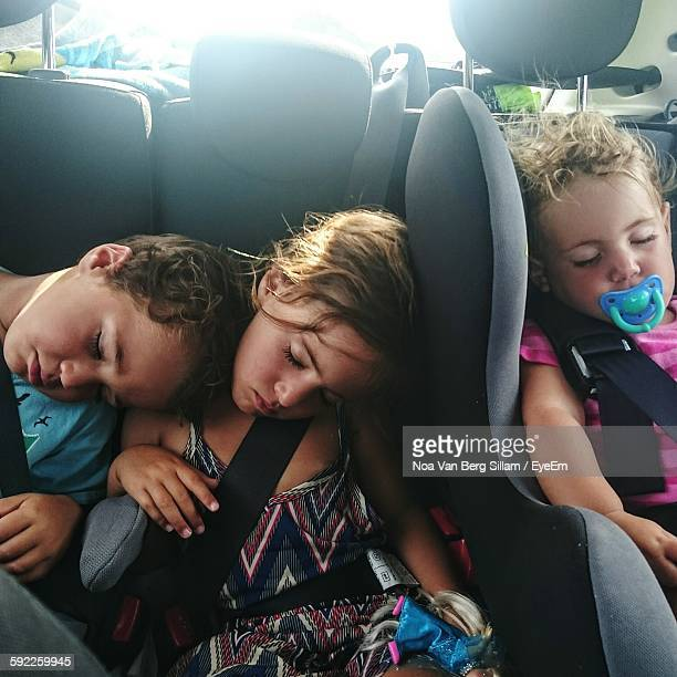 Siblings Sleeping While Sitting In Bus