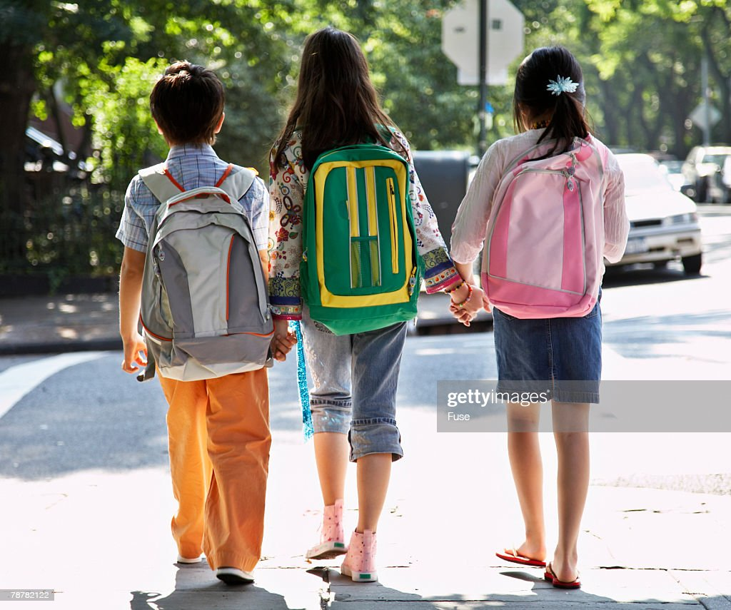 Siblings Walking to School