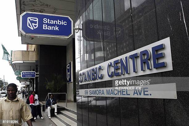 Sibongile Khumalo Zimbabweans waiting in front of a South African Standard Bank branch Stanbic Bank in Harare on July 12 2008 South African firms are...