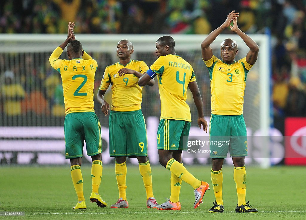 Siboniso Gaxa Katlego Mphela Aaron Mokoena and Tsepo Masilela of South Africa applaud the fans after a draw in the 2010 FIFA World Cup South Africa...