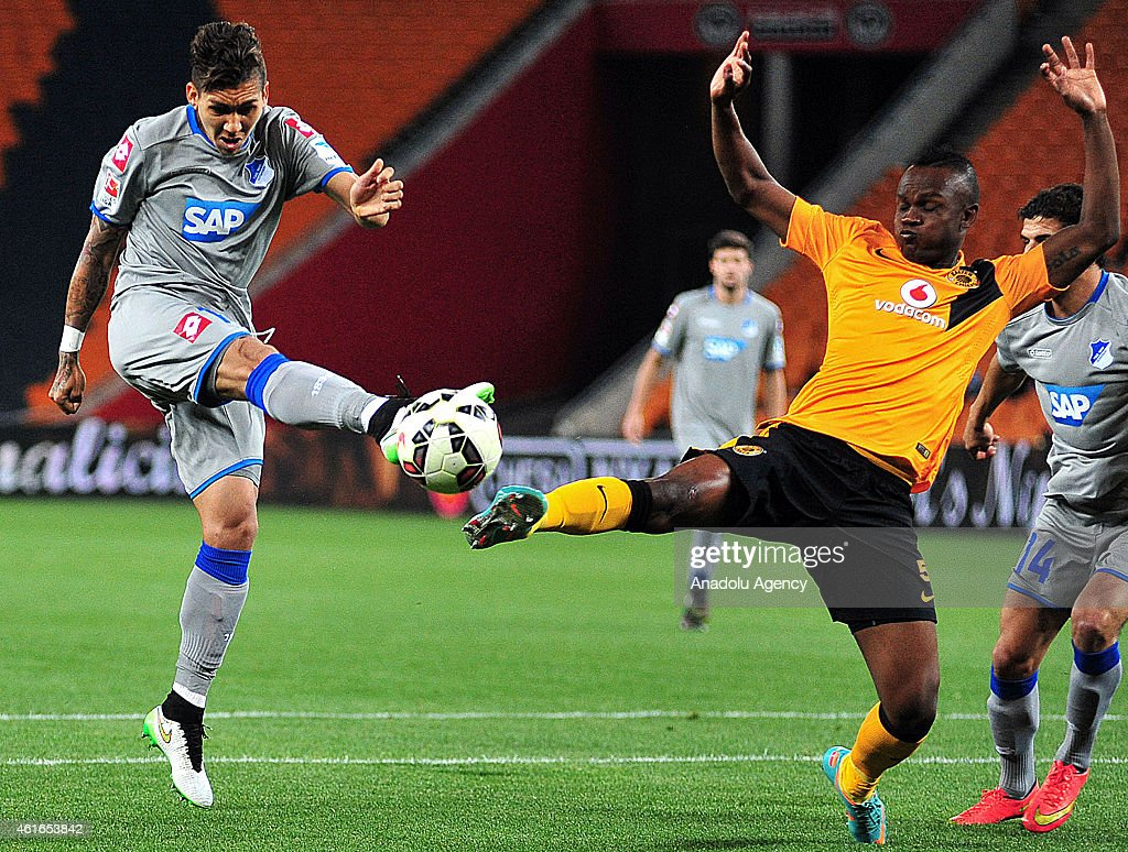 Siboniso Gaxa of Kaizer Chiefs vies for the ball with Roberto Firmino of Hoffenheim during a friendly soccer match between Kaizer Chiefs and TSG 1899...