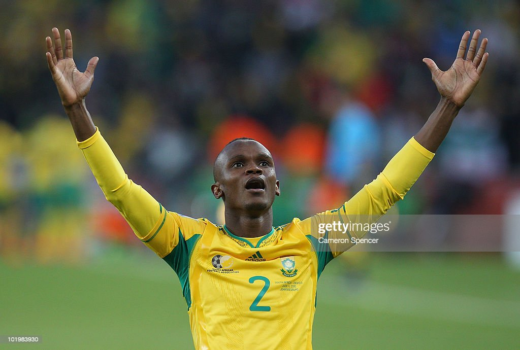 Siboniso Gaxa of South Africa celebrates Siphiwe Tshabalala scoring the first goal during the 2010 FIFA World Cup South Africa Group A match between...