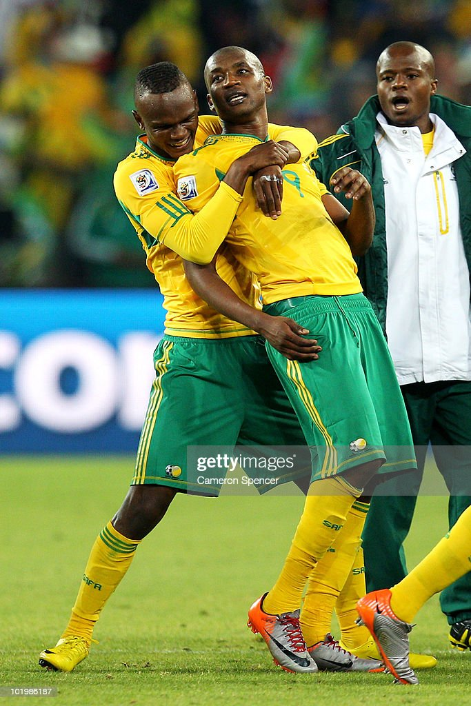 Siboniso Gaxa of South Africa celebrates with Katlego Mphela of South Africa during the 2010 FIFA World Cup South Africa Group A match between South...