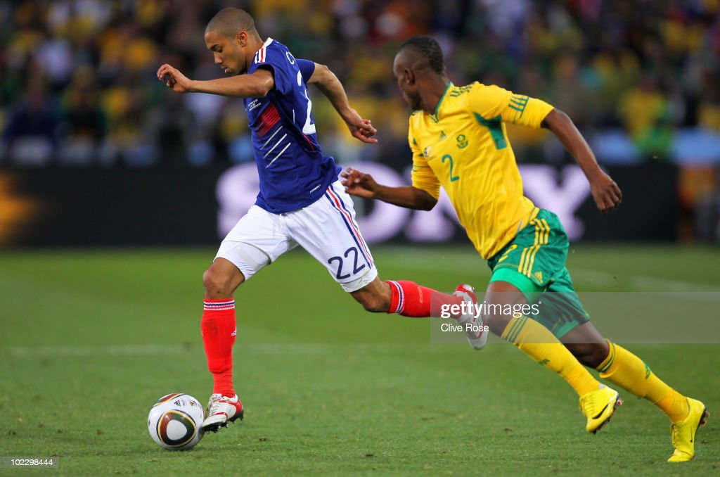 Siboniso Gaxa of South Africa pursues Gael Clichy of France during the 2010 FIFA World Cup South Africa Group A match between France and South Africa...