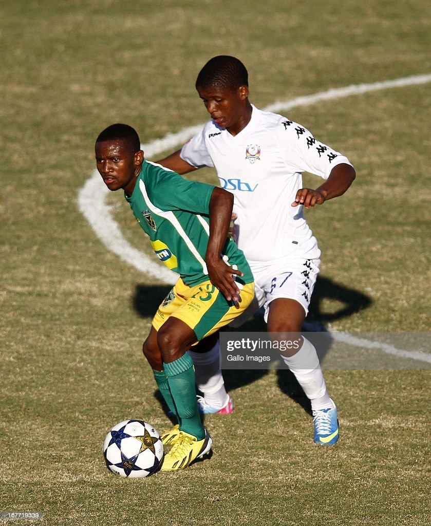 Sibusiso Hadebe holds off Thabo Moloi during the Absa Premiership match between Golden Arrows and SuperSport United at Princess Magogo Stadium on April 28, 2013 in Durban, South Africa.