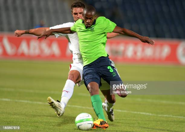 Sibusiso Msomi of Stars and Roger Da Costa during the Absa Premiership match between Moroka Swallows and Platinum Stars at Volkswagen Dobsonville...