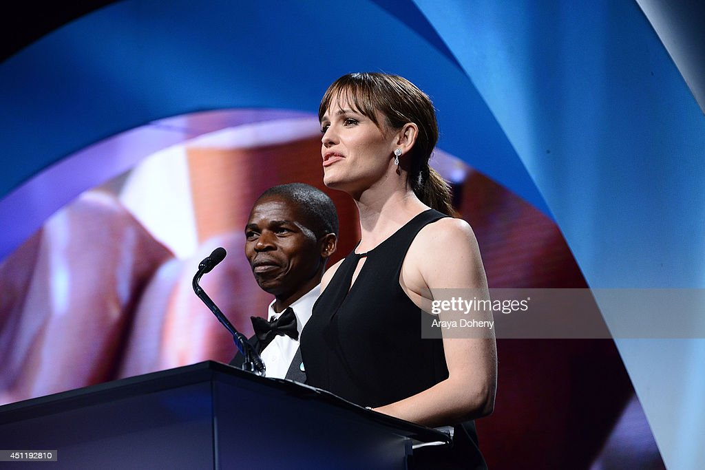 Sibusiso Shiba and <a gi-track='captionPersonalityLinkClicked' href=/galleries/search?phrase=Jennifer+Garner&family=editorial&specificpeople=201813 ng-click='$event.stopPropagation()'>Jennifer Garner</a> attend the 5th Annual Thirst Gala hosted by <a gi-track='captionPersonalityLinkClicked' href=/galleries/search?phrase=Jennifer+Garner&family=editorial&specificpeople=201813 ng-click='$event.stopPropagation()'>Jennifer Garner</a> in partnership with Skyo and Relativity's 'Earth To Echo' at The Beverly Hilton Hotel on June 24, 2014 in Beverly Hills, California.