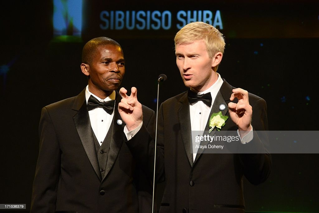 Sibusiso Shiba and Seth Maxwell speak at The Thirst Project 4th annual gala and performance at The Beverly Hilton Hotel on June 25, 2013 in Beverly Hills, California.