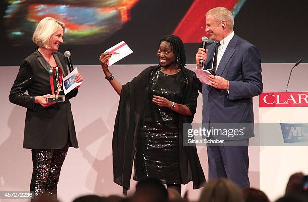 Sibylle Bassler Mona Lisa Auma Obama founder 'Sauti Kuu' and Christian Courtin Clarins CEO Clarins attend the Prix Courage Award 2014 on October 15...