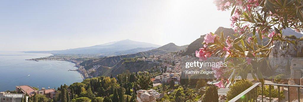 Sicilian coastline at Taormina with Mount Etna