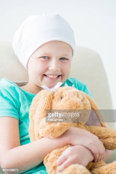 Sick Child Holding Toy