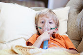 Sick Child Takes Breathing Treatment