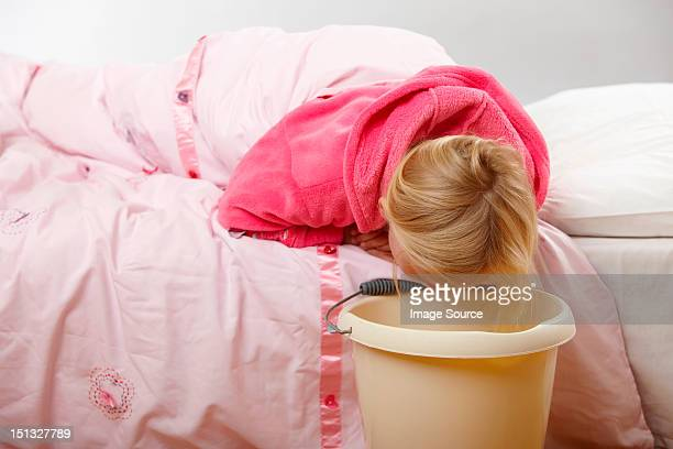 Sick girl with bucket