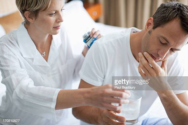 Sick man taking antacid