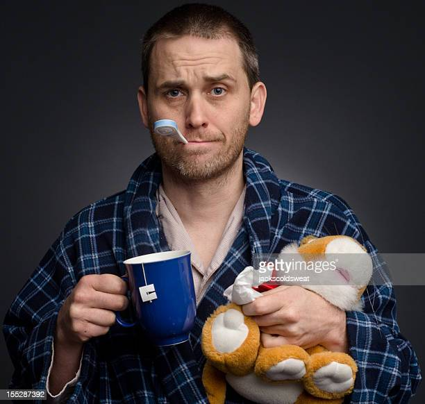 Sick man with stuffed animal