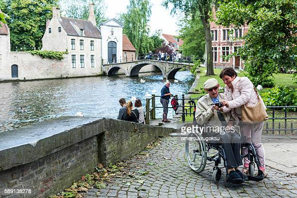Sick old man sitting in a wheelchair, Bruges