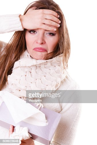 Sick woman girl with fever sneezing in tissue : Stock Photo