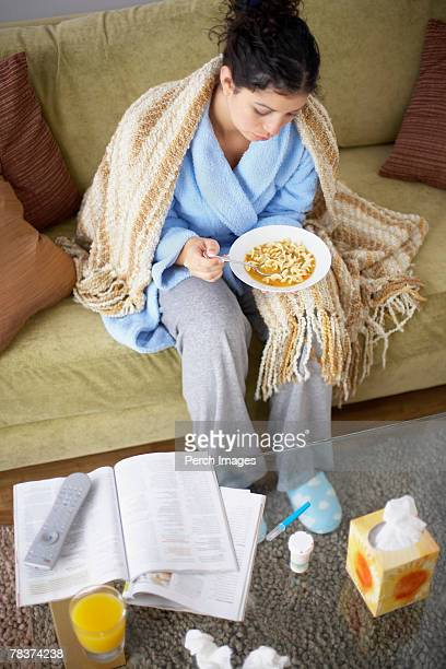Sick woman sitting on couch