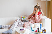 Sick woman working on laptop from home