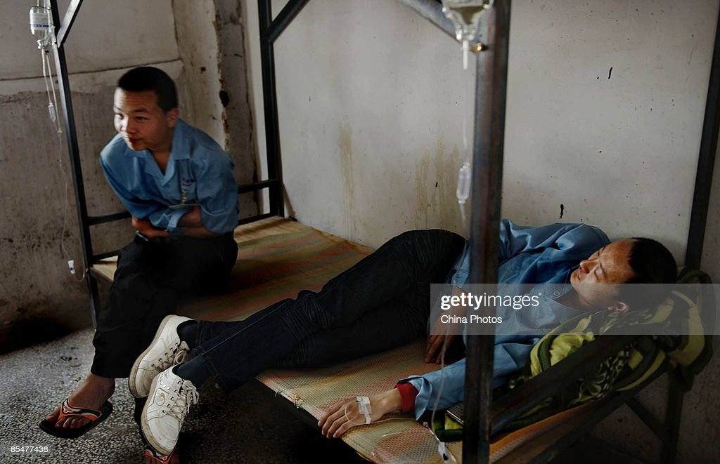 A sick worker rests after being hooked up to an IV drip at the Shenzhen Quanshun Human Resources Co. Ltd. on February 26, 2009 in Shenzhen, Guangdong Province, China. The company, which was established by entrepreneur Zhang Quanshou, supplies workers to enterprises in the Guangdong and Fujian provinces. Since 1997 Zhang has recruited migrant workers and leased them to factories, once the production order of a company is finished workers are then transferred to another one.