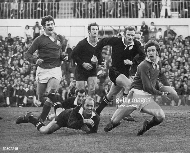 Sid Going fails to tackle Welsh player Barry John in the fourth test match at Auckland during the British Lions' tour of New Zealand 14th August 1971...