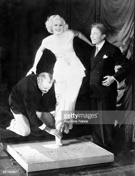 Sid Grauman's Chinese Theatre Director takes Jean Harlow's footprint in Los Angeles California in 1933