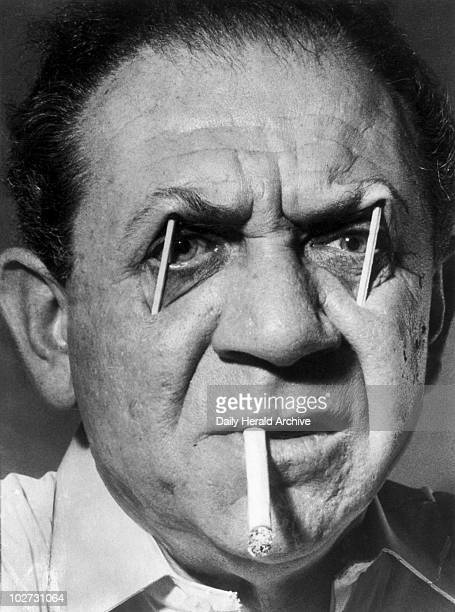 Sid James with matchsticks in his eyes whilst smoking a cigarette 1959 British actor and comedian Sid James using matchsticks to keep his eyes open...