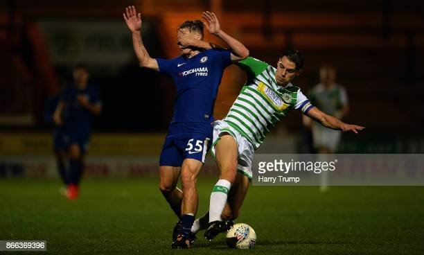 Sid Nelson of Yeovil Town puts his hand in the face of Luke McCormick of Chelsea u21 as he is tackled during the Checkatrade Trophy match between...