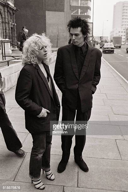 Sid Vicious guitarist with the Sex Pistols and girlfriend Nancy Spungen from Philadelphia arrive at court 2/8 where they are charged with having...