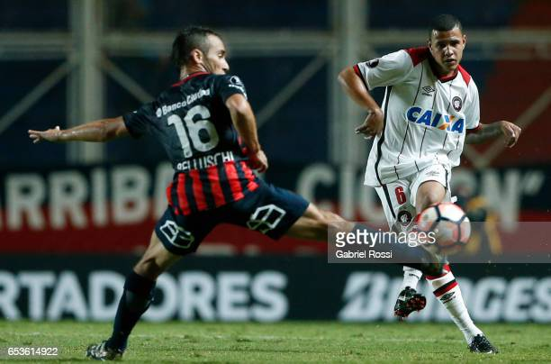 Sidcley of Atletico Paranaense fights for the ball with Fernando Daniel Belluschi of San Lorenzo during a group stage match between San Lorenzo and...