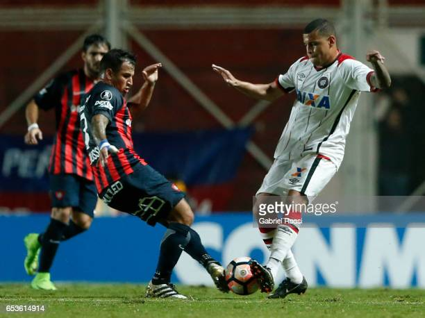 Sidcley of Atletico Paranaense fights for the ball with Franco Gabriel Mussis of San Lorenzo during a group stage match between San Lorenzo and...