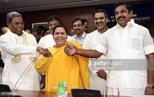 Siddaramaiah Chief Minister of Karnataka Union Minister for Water Resources Uma Bharti and Edappadi K Palanisamy PWD Minister of Tamil Nadu Minister...
