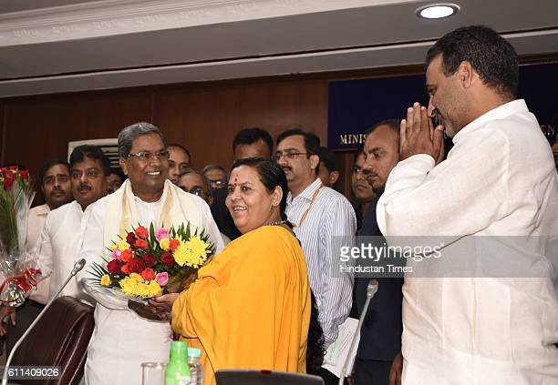 Siddaramaiah Chief Minister of Karnataka with Union Minister for Water Resources Uma Bharti and Minister of State for Water Resources Sanjeev Kumar...