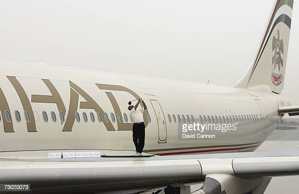 Siddarth Shriram of India hits a ball from the wing of an Etihad Airways Airbus A340 during the 'Etihad Airways Swing on the Wing Challenge' on the...