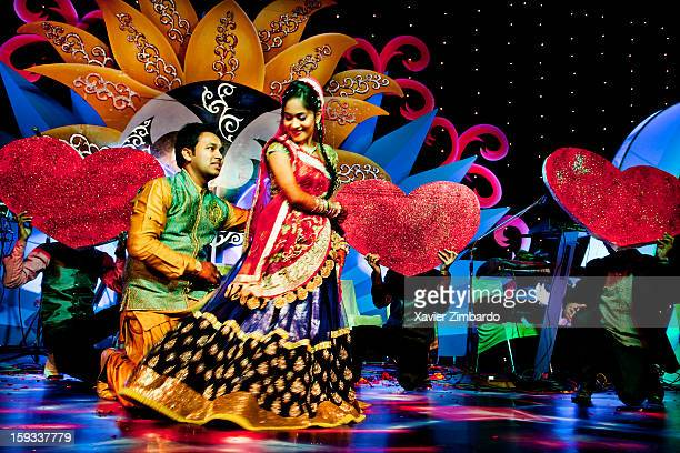 """Siddharth and Megha the groom and bride wearing traditional attire dancing on stage on a bollywood song at the """"Sangeet' Function on January 2 2012..."""