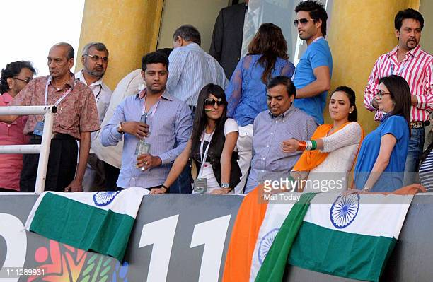Siddharth Mallya Mukesh Ambani Preity Zinta and Nita Ambani watching the match during the first innings of the ICC cricket world cup semifinal match...