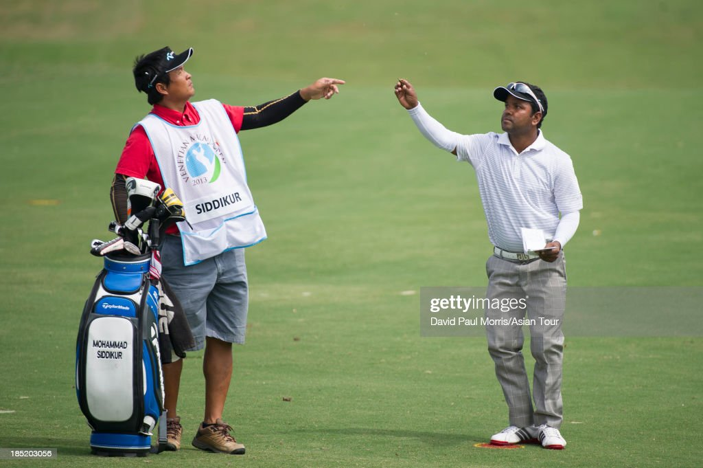 Siddikur of Bangladesh checks the wind on the 8th hole during round two of the Venetian Macau Open on October 18, 2013 at the Macau Golf & Country Club in Macau. The Asian Tour tournament offers a record US$ 800,000 prize money which goes through October 20.