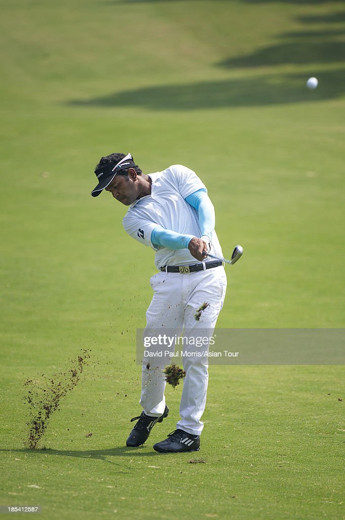 Siddikur of Bangladesh hits his second shot on the 3rd hole during round four of the Venetian Macau Open on October 20, 2013 at the Macau Golf & Country Club in Macau. The Asian Tour tournament offers a record US$ 800,000 prize money which goes through October 20.