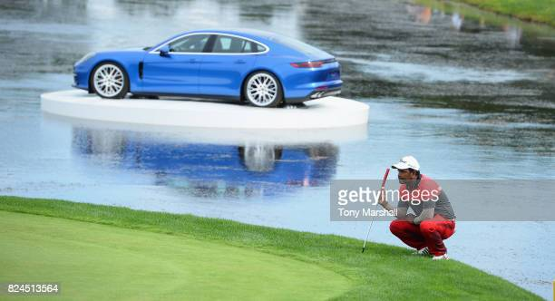 Siddikur Rahman of Bangladesh lines up his putt on the 18th green during the Porsche European Open Day Four at Green Eagle Golf Course on July 30...