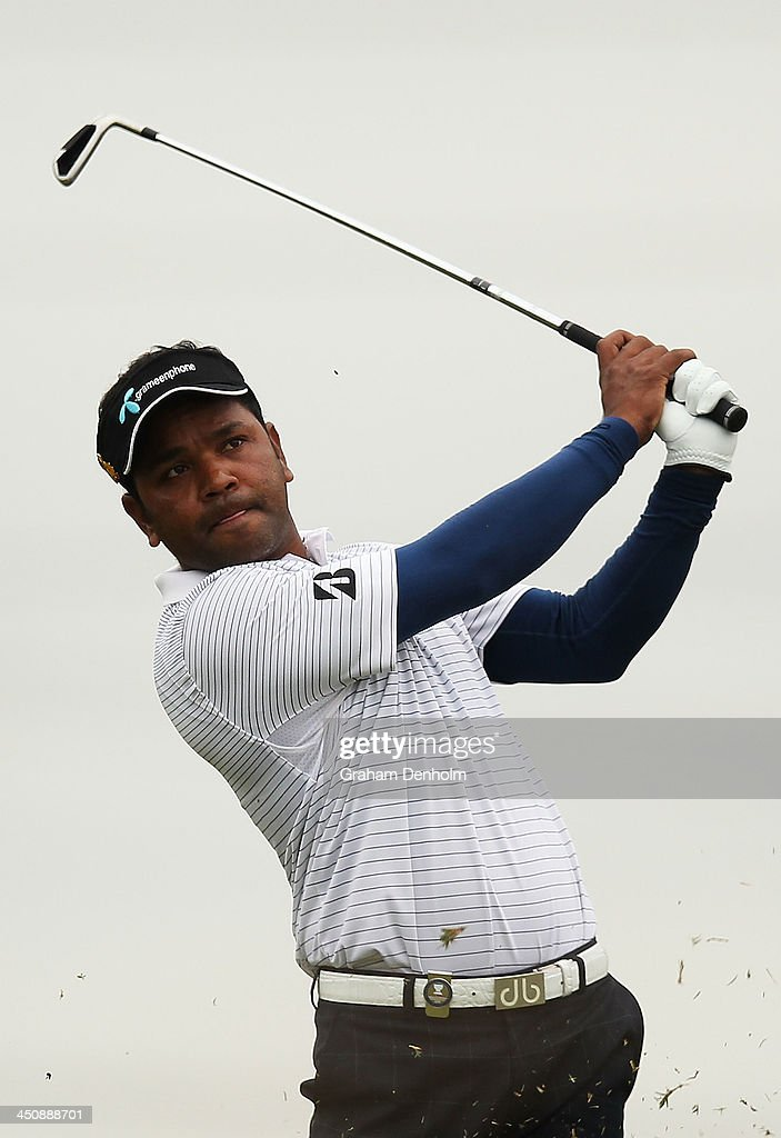 Siddikur Rahman of Bangladesh plays an approach shot from the fairway during day one of the World Cup of Golf at Royal Melbourne Golf Course on November 21, 2013 in Melbourne, Australia.