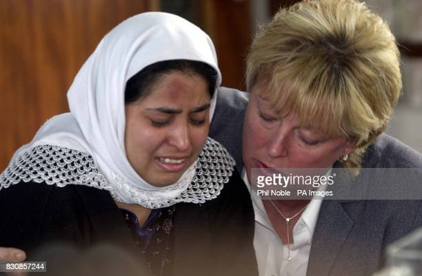 Siddiquh Aziz is comforted by a Police officer during a press conference at Huddersfield Police Station where her father Abdul Aziz Chishti who lost...