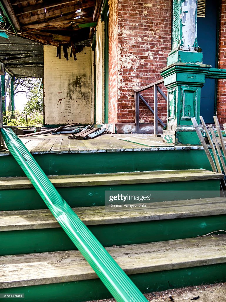 Side porch on abandoned building