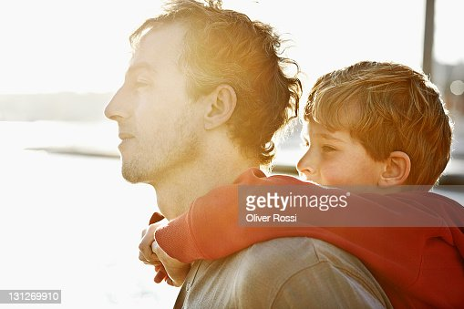 side portrait of a father and son : Stock Photo