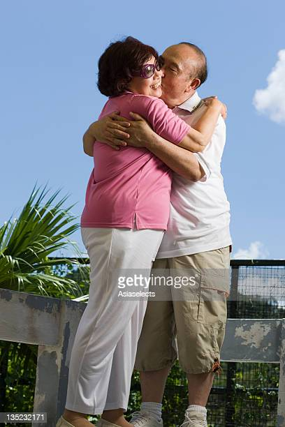 Side profile of a couple embracing each other