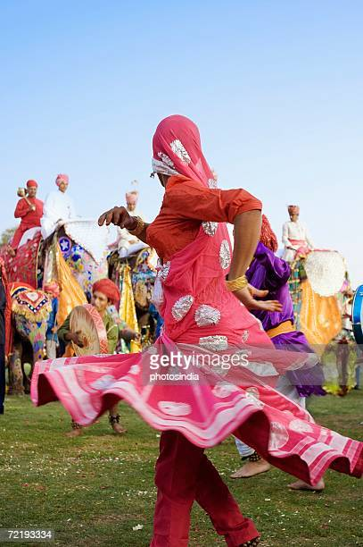 Side profile of a female performer dancing, Elephant Festival, Jaipur, Rajasthan, India