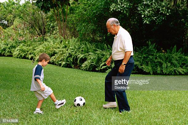 side profile of a grandfather and grandson playing football