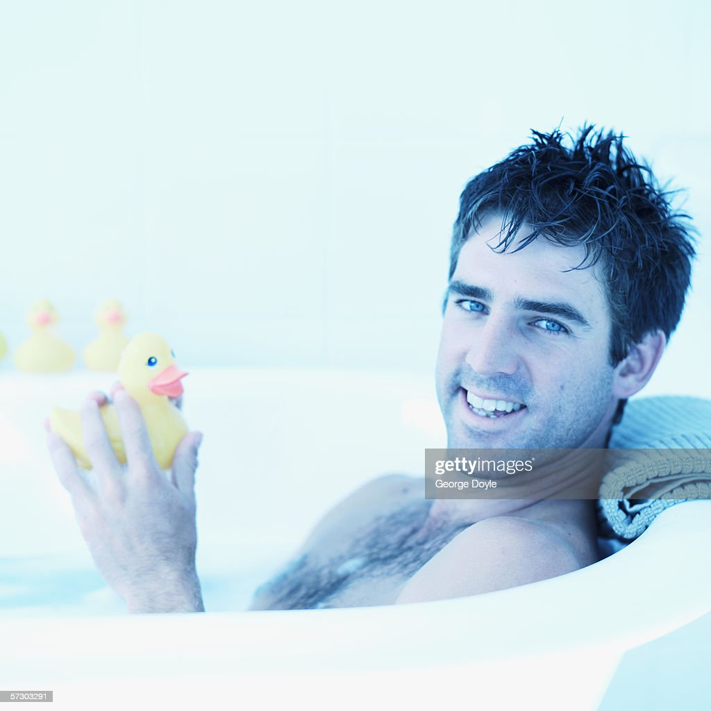 side profile of a man in a bathtub holding a rubber duck. Black Bedroom Furniture Sets. Home Design Ideas