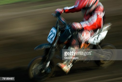 Side profile of a man on a racing bike : Stock Photo