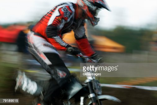 Side profile of a man on a racing bike : Foto de stock