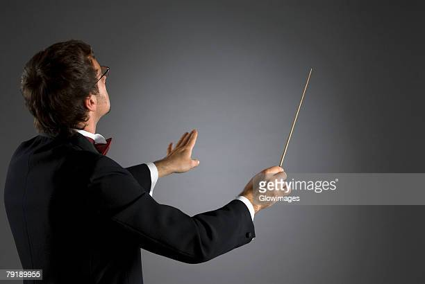 Side profile of a music conductor performing